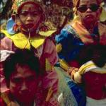 Young Shan males entering monastery for the first time, dressed in finery to resemble princes. Held once a year in March/April in Thailand and Burma.