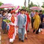The wedding procession to the bride's house. Vietnamese weddings are far more participatory than traditional western weddings.