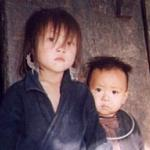 Two young Hmong children in Sapa Valley village.