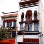 With its arches, columns, and recessed balconies, this building is typical of those found in Chinatown at the turn of the twentieth century.