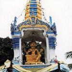 One common variation on the spirit house looks like a miniature Khmer-style temple, and houses a four-faced image of Brahma, the Hindu creator-god, together with his bird-vehicle and thunderbolt.