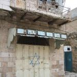 Star of David spray painted on an Arab shop, next to a mosque in Hebron, Israel.