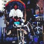 Pedicab driver, ever vigilant for customers on the bustling streets of Thamel.