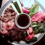 Grilled beef and shrimp, stir-fried mushrooms, fresh cucumber, radishes and snow peas, spicy kimchi, grilled scallions and homemade salt pickles. An assortment of fillings to be wrapped in thin, delicate pancakes and dipped in a savory soy-ginger-garlic sauce.