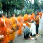 Early morning risers in Luang Prabang will witness a sea of orange walking down the streets.