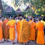 Monks at Wat Sop in Luang Prabang gather to watch a puppet show.