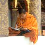 A monk at Luang Prabang's Wat Saen bundles up on a cold February day.