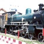 Picturesque old engine sits in front of the Phitsanulok Train Station.