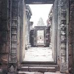 Phimai, Thailand: The outer wall is connected to the inner wall, or gallery, by a raised passageway, and even from this remove the central tower can be seen.