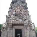 Phimai, Thailand: The main tower, built of white sandstone during the 11th and 12th centuries, features garuda caryatids, antefixes of hooded serpents, and a lotus-bulb filial. Bas-reliefs and lintels depict dancing Sivas, scenes from the Ramayana and the Buddha's life.