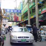 Narrow streets, with goods stacked up outside the shop...
