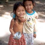 Smiling faces, like those on these two young girls, can be seen all around Phnom Penh.