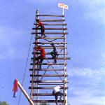 A team mounts their entry onto a rickety launch pad in preparation for the Bun Bang Fai festival in Yasothon, Thailand.