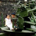 Children play on anti-aircraft gun at the Army Museum.