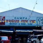 The Dampa Wet Market, featuring fresh-caught seafood and Colt. 45 malt liquor.