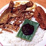 Nasi lemak is the trademark meal for Malays. Nasi means rice in Malay. Rice cooked in rich coconut milk is eaten with fried chicken, fried ikan bilis (anchovies), achar (a kind of seasoned vegetable salad), a fried egg and a dollop of spicy sambal chilli.