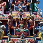 Details of the gopuram over the entrance of the temple. The five-tiered tower is crowded with figurative sculptures of gods, goddesses and beasts.