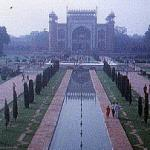 Agra, India. The Taj's massive compound is a rectangle oriented north-south, 1900 feet by 1000 feet. Within it is a garden 1000 feet square, lined with paths and quadrasected by a reflective canal. At the compound's southern end is an edifice, architecturally significant in its own right, serving as an entrance.