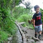 """A young boy demonstrates the miracle of """"Water Running Up"""""""